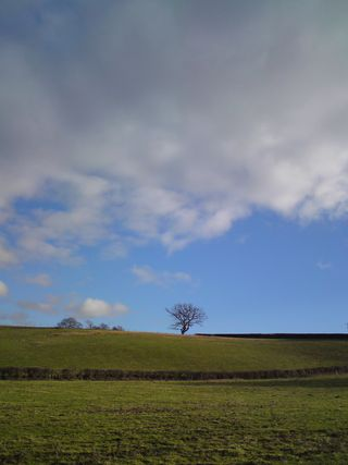 Blue sky and black clouds